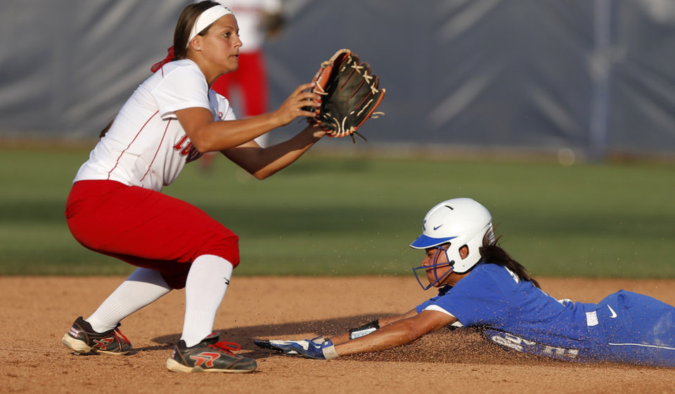 Photo - Kentucky's Sylver Samuel (2) steals second base under La.-Lafayette's Natalie Fernandez (3) in the fifth inning of a Women's College World Series game between La.-Lafayette and Kentucky at ASA Hall of Fame Stadium in Oklahoma City Thursday, May 29, 2014. Photo by Bryan Terry, The Oklahoman