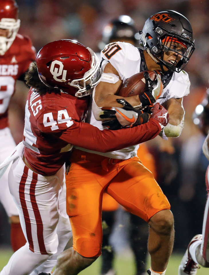 Photo - Oklahoma State's Chuba Hubbard (30) is tackled by Oklahoma's Brendan Radley-Hiles (44) at the end a run in the fourth quarter of a Bedlam college football game between the University of Oklahoma Sooners (OU) and the Oklahoma State University Cowboys (OSU) at Gaylord Family-Oklahoma Memorial Stadium in Norman, Okla., Nov. 10, 2018. OU won 48-47. Photo by Nate Billings, The Oklahoman