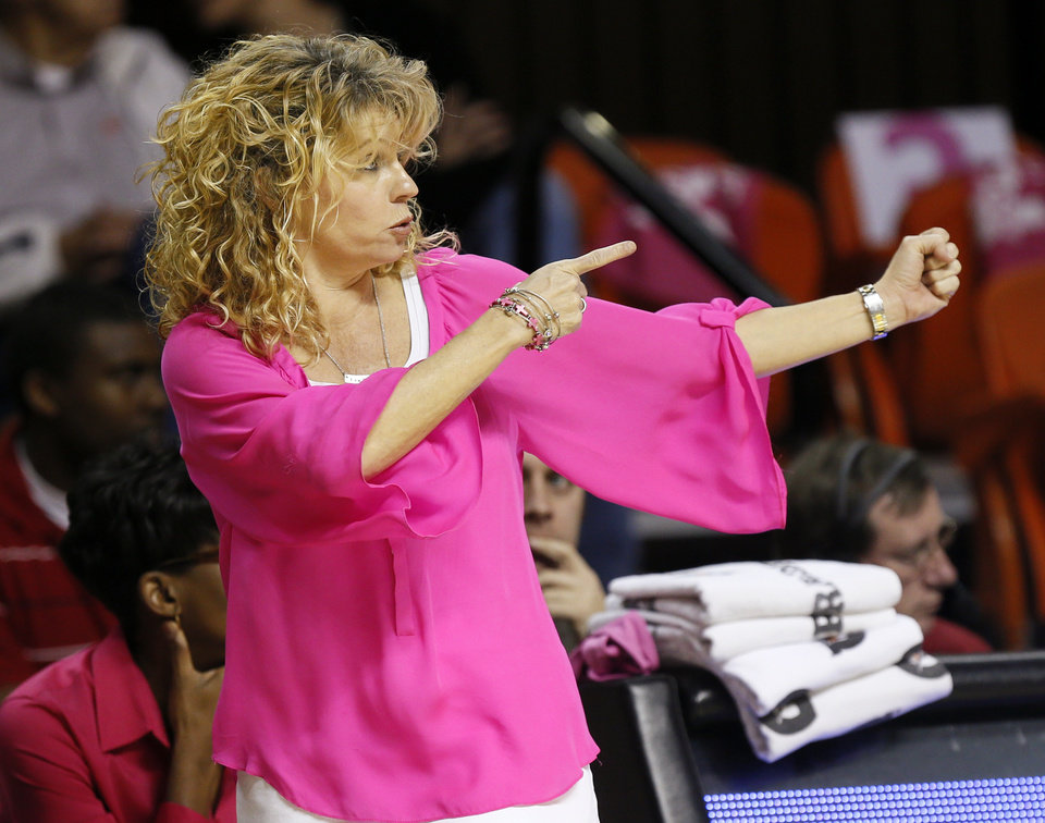 Photo - Oklahoma head coach Sherri Coale gives interactions to her team in the first half during the women's Bedlam college basketball game between the OU Sooners and the OSU Cowgirls at Gallagher-Iba Arena in Stillwater, Okla., Sunday, Feb. 16, 2014. Photo by Nate Billings, The Oklahoman