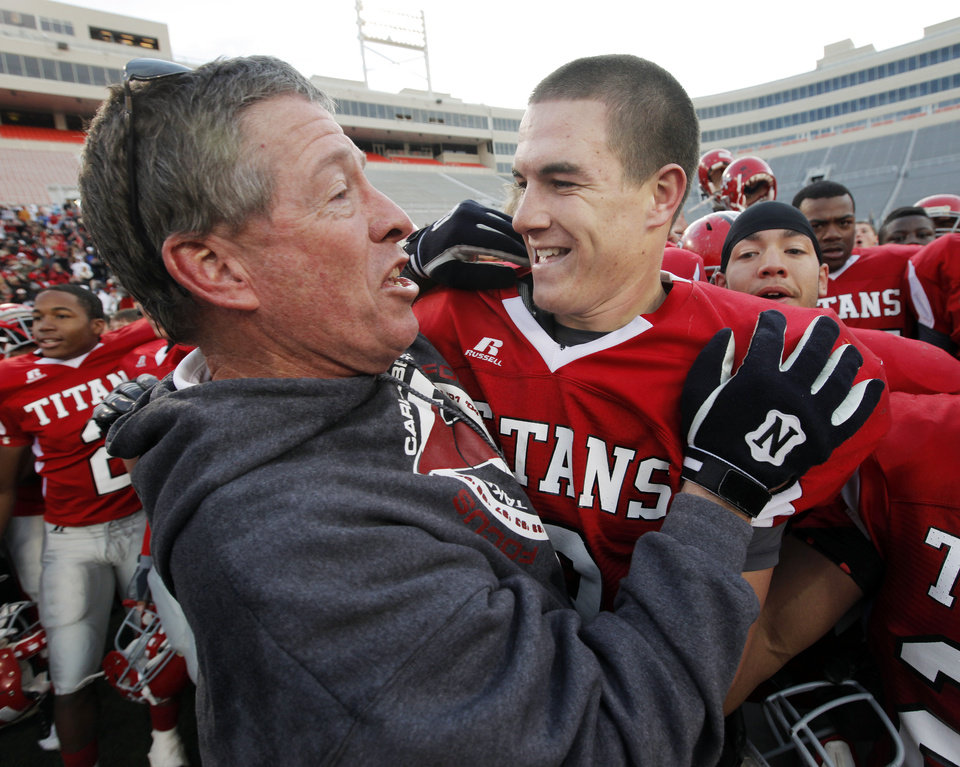 Carl Albert head coach Gary Rose, left talks to quarterback J.T. Realmuto after the Class 5A state high school football championship game between Bixby and Carl Albert at Boone Pickens Stadium in Stillwater, Okla., Saturday, December 5, 2009. Carl Albert won, 21-7.  Photo by Nate Billings, The Oklahoman