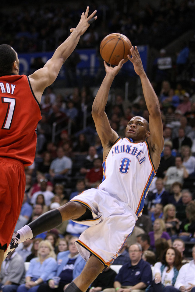 Photo - OKLAHOMA CITY THUNDER / PORTLAND TRAIL BLAZERS / NBA BASKETBALL  Oklahoma City's Russell Westbrook shoots a fallaway jumper over Portland's Brandon Roy during the Thunder - Portland game April 3, 2009 in the Ford Center in Oklahoma City.    BY HUGH SCOTT, THE OKLAHOMAN ORG XMIT: KOD