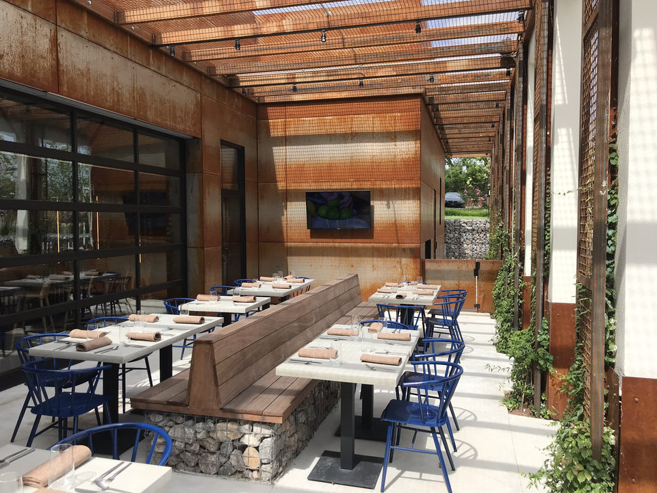 Photo - Covered patio seating is plentiful at Frida Southwest, a new restaurant concept from Humankind Hospitality in the Paseo Arts District. [Dave Cathey/The Oklahoman]