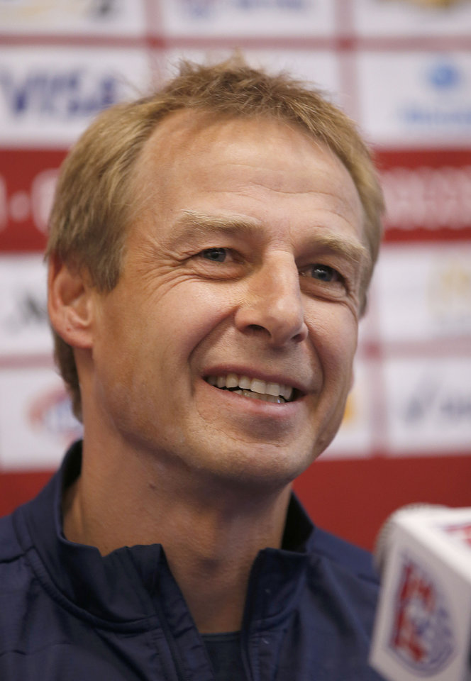 Photo - CORRECTS NAME TO  KLINSMANN - U.S. Men's National Team Head Coach Jurgen Klinsmannn answers questions during a news conference on Wednesday, May 14, 2014, Stanford, Calif.  The US national soccer team kicked off its preparation camp at Stanford University preparing for the World Cup tournament, which gets underway in June. (AP Photo/Tony Avelar)
