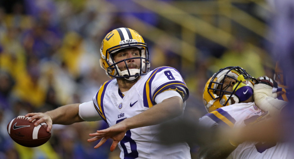 Photo - LSU quarterback Zach Mettenberger (8) passes in the first half of an NCAA college football game against Texas A&M in Baton Rouge, La., Saturday, Nov. 23, 2013. (AP Photo/Gerald Herbert)