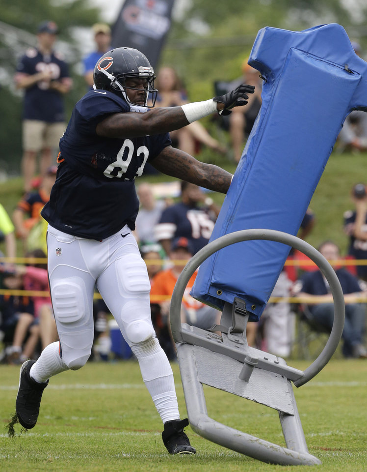 Photo - Chicago Bears tight end Martellus Bennett (83) works on the field during NFL football training camp Wednesday, July 31, 2013, in Bourbonnais, Ill. (AP Photo/Nam Y. Huh)