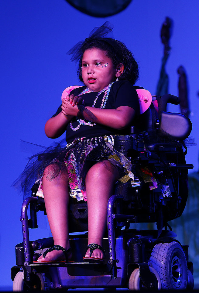 Photo - Bri Johnson performs during a musical show Thursday at Special Care in Oklahoma City.  Photo by Sarah Phipps, The Oklahoman  SARAH PHIPPS