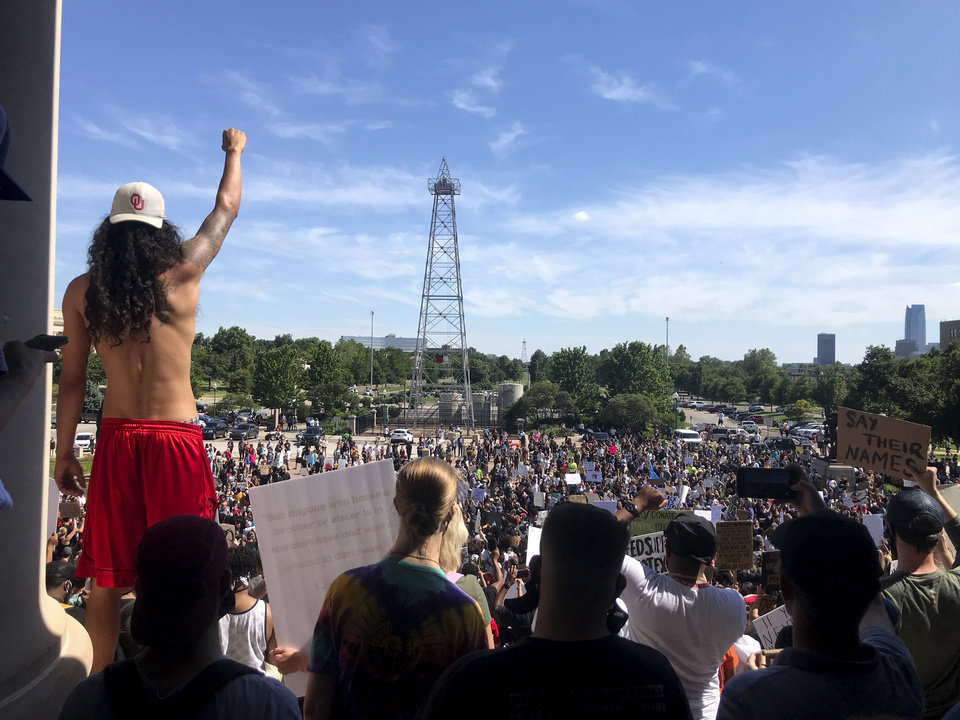 Photo - Protestors rally during a  Black Lives Matter rally in Oklahoma City,  Sunday, May 31, 2020.  [Bryan Terry/The Oklahoman]