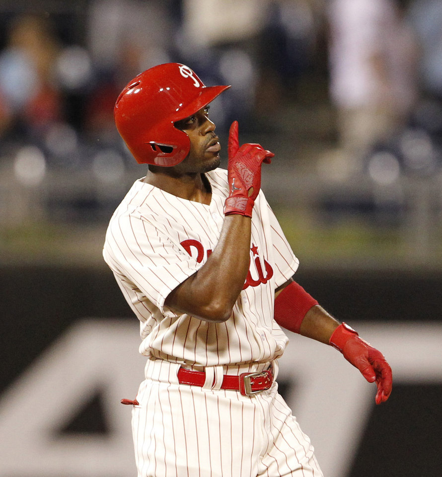 Photo - Philadelphia  Phillies Jimmy Rollins  reacts after hitting a double in the ninth inning of a baseball game against the Chicago Cubs to tie Mike Schmidt for career hits,  Friday, June 13, 2014 at Citizens Bank Park in Philadelphia.   ( AP Photo / The Philadelphia Inquirer, Ron Cortes)