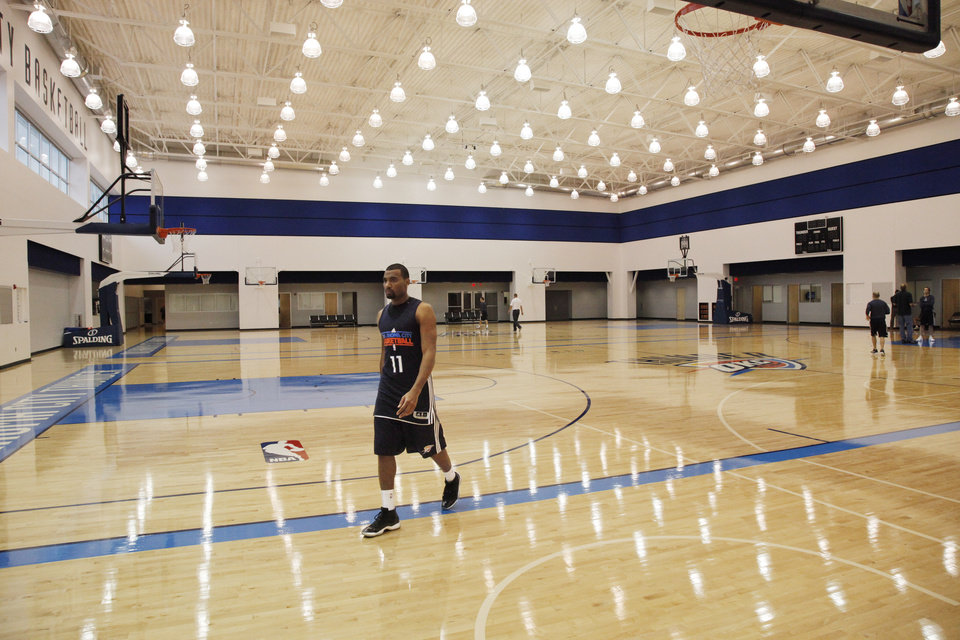 Photo - New Thunder player Lazar Hayward walks over to talk with the media at the end of a practice session at the Thunder Practice Facility, Wednesday, Dec. 14, 2011. Photo by Doug Hoke, The Oklahoman