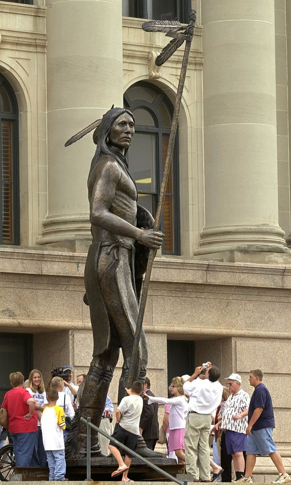 "Visitors gather at the bottom of ""The Guardian"" Wed., June 5, 2002, on the steps of the Oklahoma Capitol building in Oklahoma City, Okla. to view The American Indian statue that will be hoisted into place on top of the Oklahoma Capitol's new Dome on Friday, June 7, at 10a.m.  Staff photo by Bryan Terry"