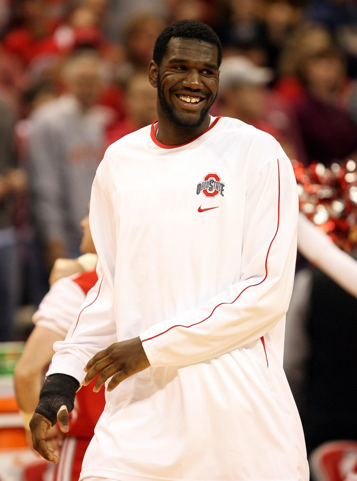 Photo - **  FILE **  In this Dec 2, 2006 file photo, Ohio State's Greg Oden smiles during warm-ups before a basketball game against Valparaiso in Columbus, Ohio. Oden arrived in Columbus heralded as the best big man in college basketball in decades, and people who have never met him are certain he will leave Ohio State after this season to turn pro.  (AP Photo/Terry Gilliam, File) ORG XMIT: CO302