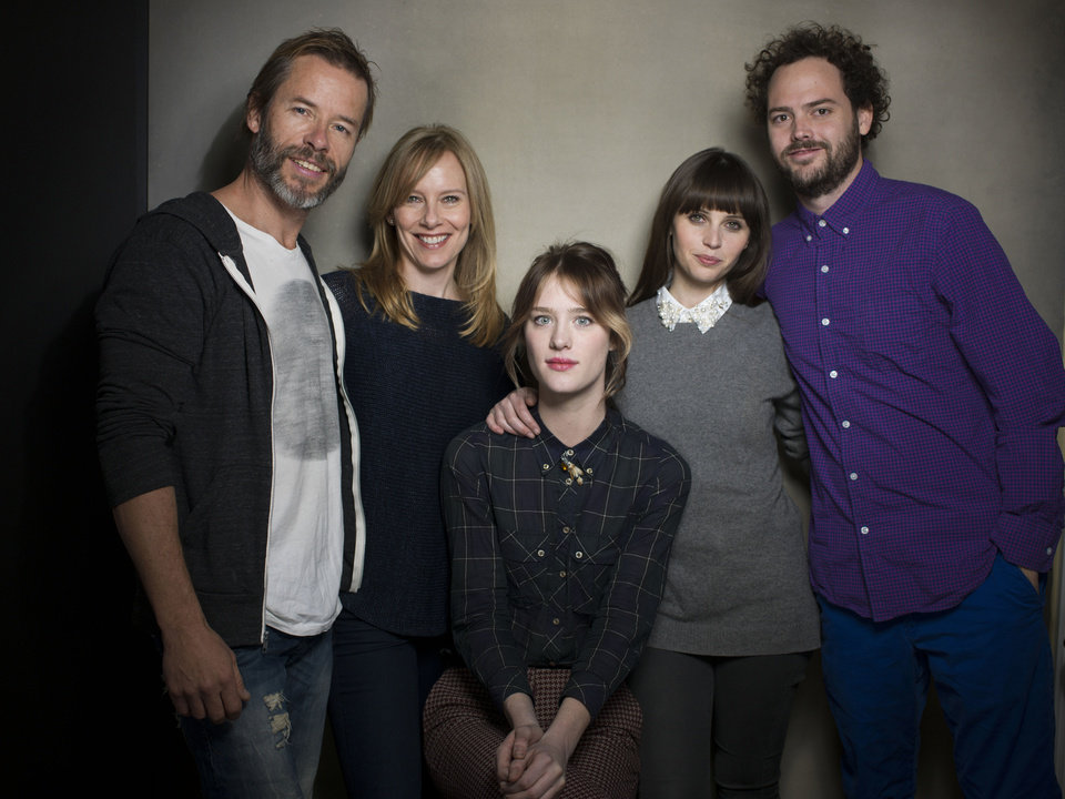 """From left, actors Guy Pearce, Amy Ryan, Mackenzie Davis, Felicity Jones and director Drake Doremus  from the film """"Breathe In"""" pose for a portrait during the 2013 Sundance Film Festival on Sunday, Jan. 20, 2013 in Park City, Utah. (Photo by Victoria Will/Invision/AP Images)"""