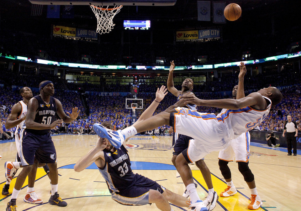 Oklahoma City\'s Kevin Durant (35) shoots as he falls to the floor during game 7 of the NBA basketball Western Conference semifinals between the Memphis Grizzlies and the Oklahoma City Thunder at the OKC Arena in Oklahoma City, Sunday, May 15, 2011. Photo by Sarah Phipps, The Oklahoman