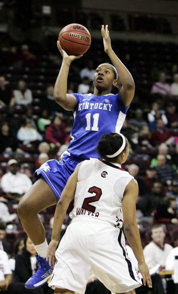 Kentucky\'s DeNesha Stallworth (11) drives for the basket as South Carolina\'s Ieasia Walker (2) tries to block during the first half of their NCAA college basketball game, Thursday, Jan. 24, 2013, in Columbia, S.C. (AP Photo/Mary Ann Chastain)
