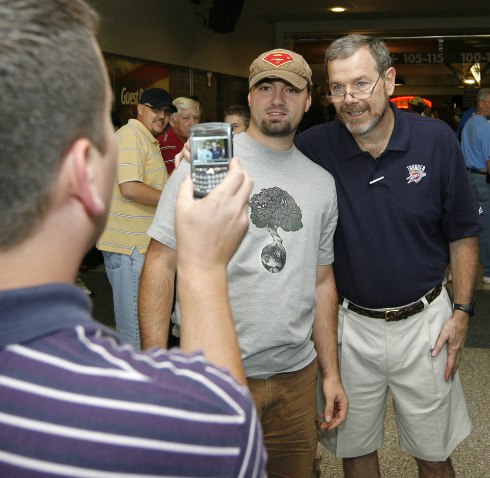 Kevin Riley takes a picture of Jared Burch with Oklahoma City head coach P.J. Carlesimo before the open practice for the Oklahoma City Thunder NBA basketball team at the Ford Center in Oklahoma City, Monday, October 20, 2008. BY NATE BILLINGS, THE OKLAHOMAN