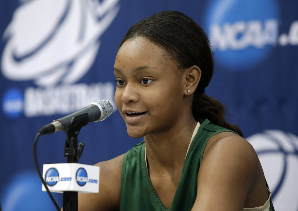 Photo - Baylor's Nina davis responds to a question during an NCAA college basketball tournament news conference on Sunday, March 23, 2014, in Waco, Texas. Baylor is scheduled to play California on Monday. (AP Photo/Tony Gutierrez)
