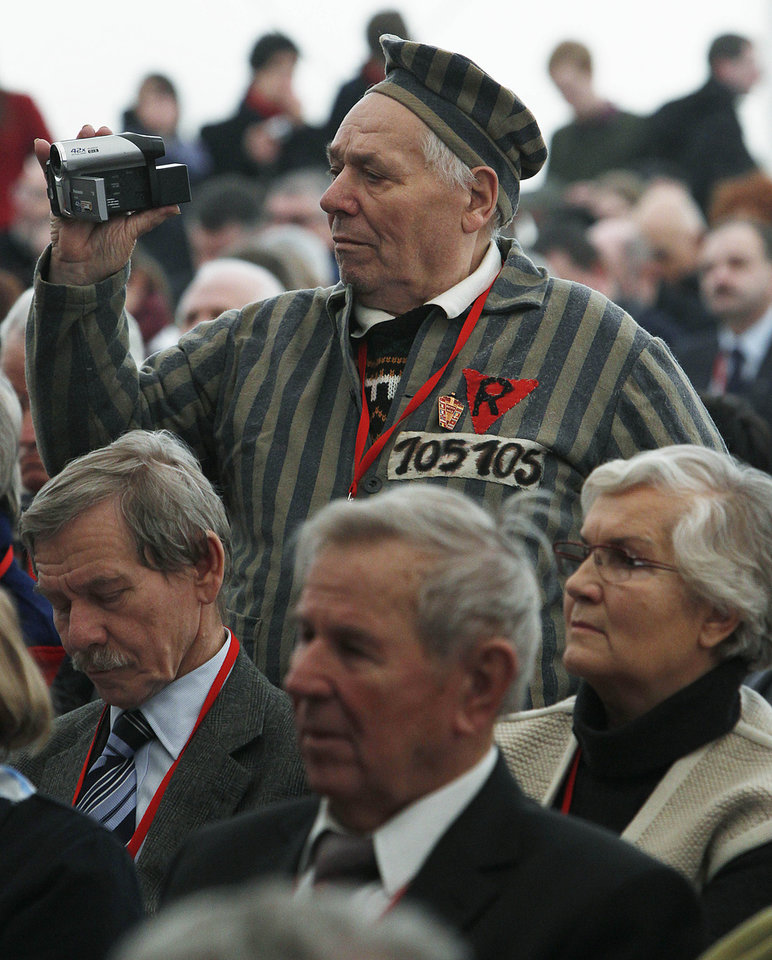 Photo - A former prisoner of the Auschwitz concentration camp  films the celebrations  in Oswiecim, Poland, Sunday, Jan. 27, 2013,  marking the 68th anniversary of the liberation of Auschwitz by Soviet troops and  remembering  the victims of the Holocaust, in Auschwitz-Birkenau.  (AP Photo/Czarek Sokolowski)