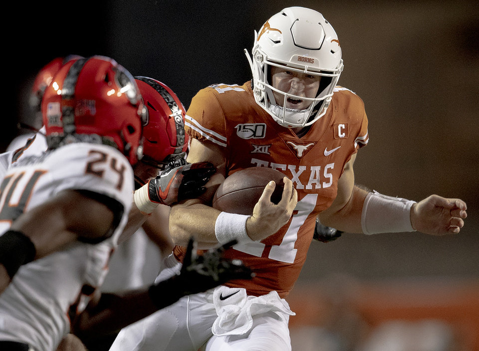 Photo - Texas quarterback Sam Ehlinger (11) runs the ball against Oklahoma State during an NCAA college football game on Saturday, Sept. 21, 2019, in Austin, Texas. (Nick Wagner/Austin American-Statesman via AP)