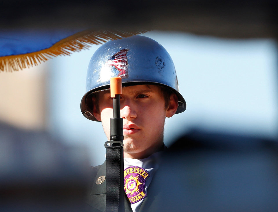 Photo - A member of the Northwest Classen High School Junior ROTC Honor Guard is  framed  through the base of the anchor memorial at a ceremony Wednesday, Dec. 7, 2011, near NW 13 and Broadway in Oklahoma City,  to commemorate the 70th anniversary of the Japanese attack on US forces at Pearl Harbor in 1941. The memorial was held  in front of the anchor salvaged from the USS Oklahoma after it sank.    Photo by Jim Beckel, The Oklahoman