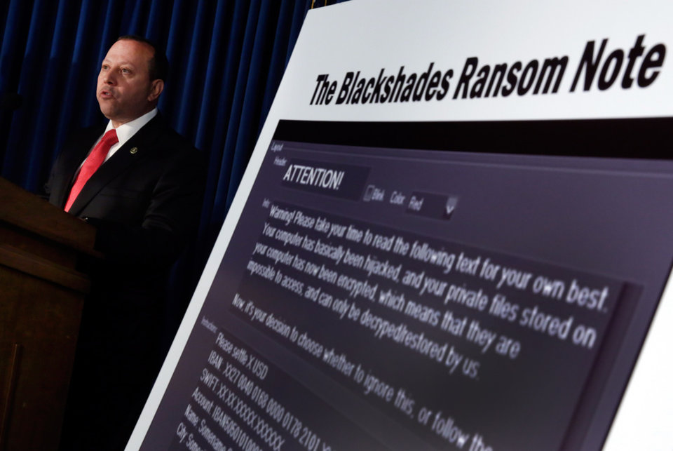 Photo - Leo Taddeo, special agent-in-charge, Federal Bureau of Investigation,Special Operations and Cyber Division, discusses arrests in the malware BlackShades Remote Access Too, during a news conferencel in New York, Monday, May 19, 2014. More than a half million computers in over 100 countries were infected by sophisticated malware that lets cybercriminals take over a computer and hijack its webcam, authorities said as charges were announced Monday against more than 100 people worldwide. (AP Photo/Richard Drew)