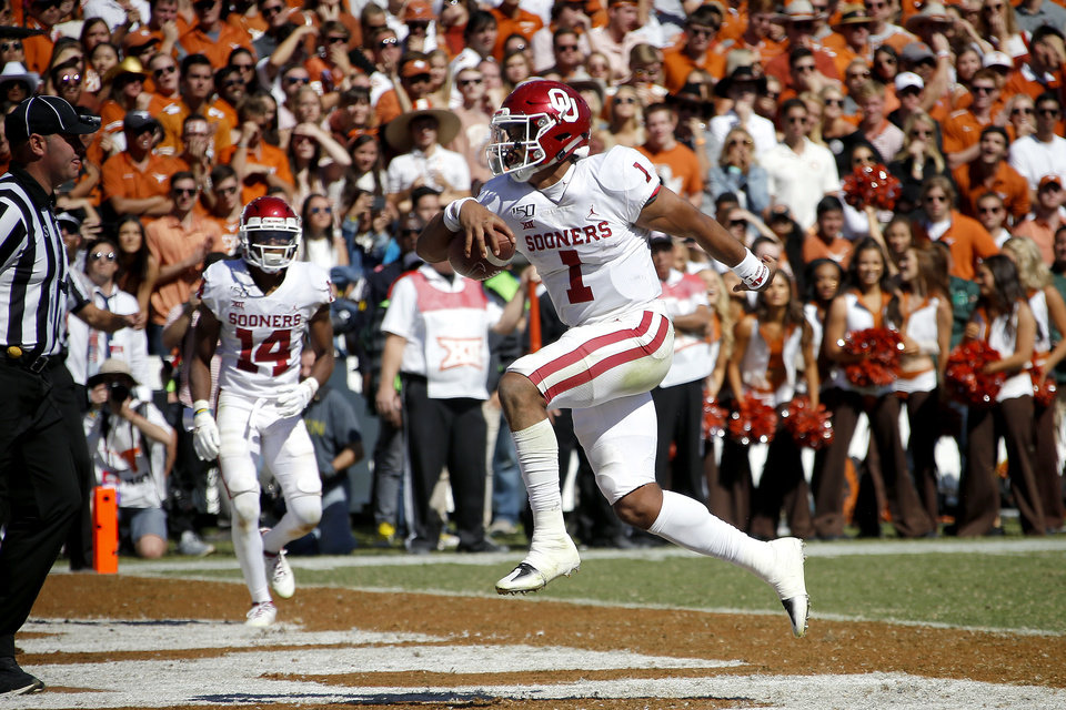Photo - Oklahoma's Jalen Hurts (1) runs a touchdown during the Red River Showdown college football game between the University of Oklahoma Sooners (OU) and the Texas Longhorns (UT) at Cotton Bowl Stadium in Dallas, Saturday, Oct. 12, 2019. Oklahoma won 34-27. [Bryan Terry/The Oklahoman]