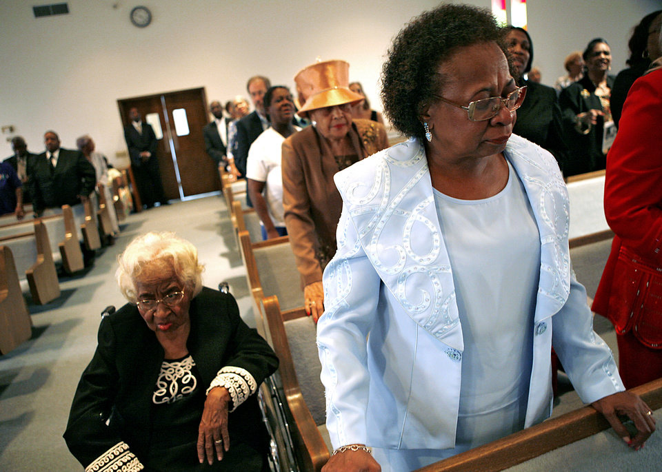 Photo - Marilyn Hildreth (right) and her mother Clara Luper join the audience as they listen to music from the choir during Freedom Fiesta's Celebration Week Doc Williams Day at Friendship Baptist Church in Oklahoma City on Sunday, August 17, 2008. By John Clanton, The Oklahoman ORG XMIT: KOD