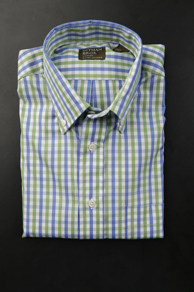 Photo - Checked and gingham print men's sport shirts are popular for spring and summer 2013, especially in pastel shades of blue and green. Shirt by Gitman Bros., sold at S.J. Haggard & Co. Photo by Doug Hoke, The Oklahoman.  DOUG HOKE