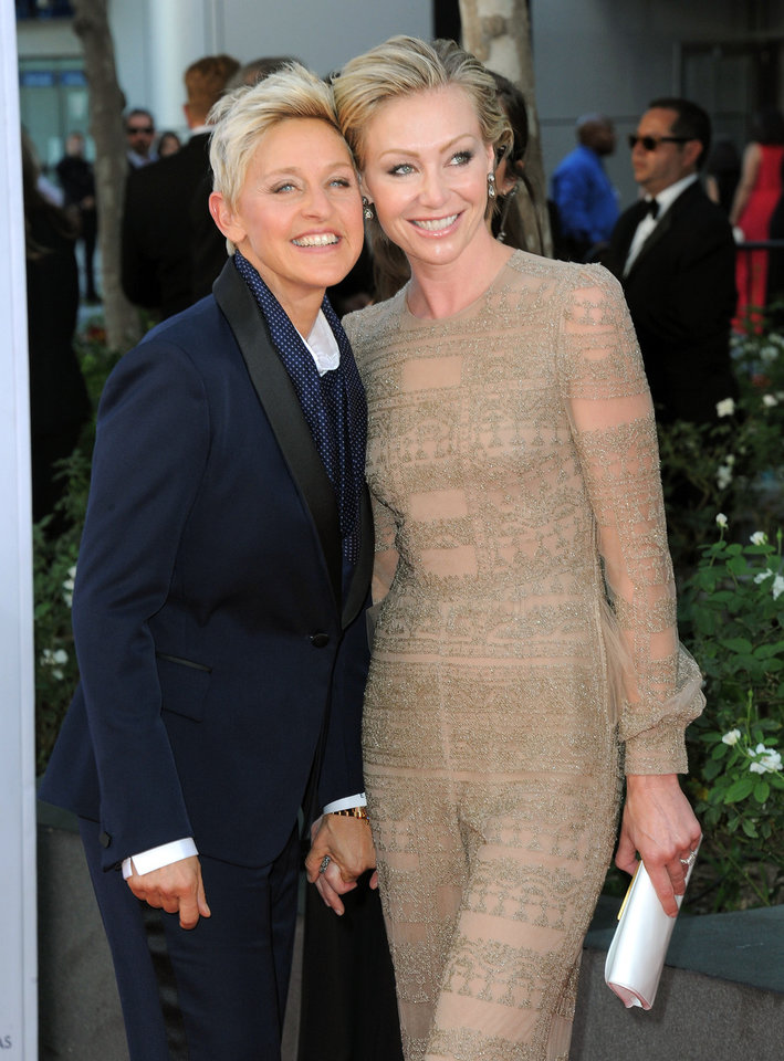 Photo -   Actresses Ellen DeGeneres, left and Portia de Rossi arrives at the 64th Primetime Emmy Awards at the Nokia Theatre on Sunday, Sept. 23, 2012, in Los Angeles. (Photo by Jordan Strauss/Invision/AP)