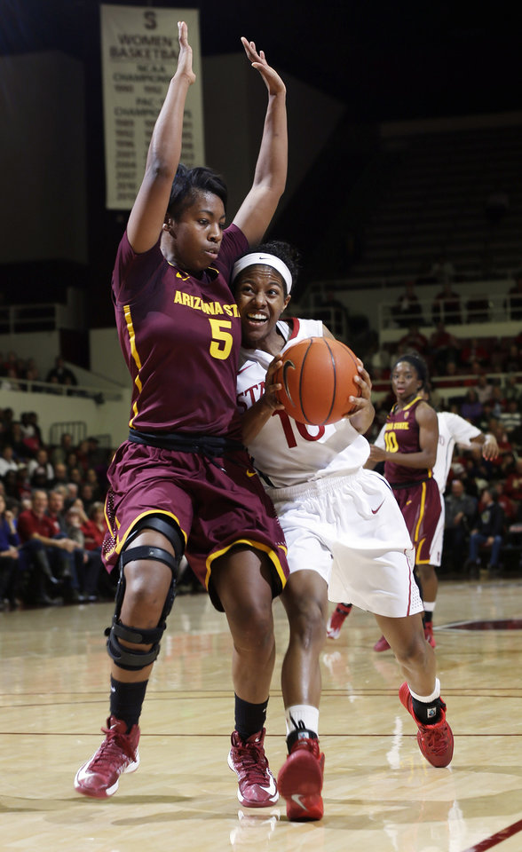 Photo - Stanford guard Briana Roberson (10) drives to the basket against Arizona State guard Deja Mann (5) during the first half of an NCAA college basketball game Friday, Feb. 14, 2014, in Stanford, Calif. (AP Photo/Marcio Jose Sanchez)