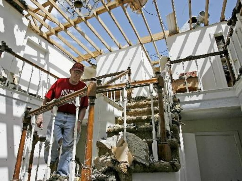 Lary Fullbright walks up the stairs of his Muldrow, Okla., home, Thursday, April 10, 2008. Fullbright's home was damaged the Wednesday night after severe storms moved through the area. Photo by Bryan Terry