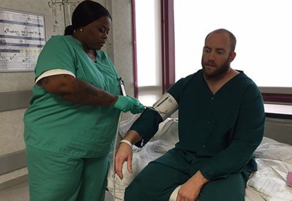 Photo -  Matt Meloni receives medical treatment for a burst appendix after wading through floodwaters to the Houston VA hospital. [Photo provided]