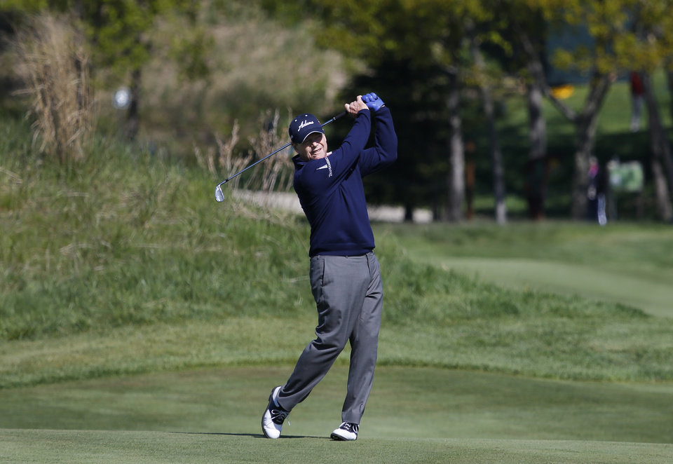 Photo - Tom Watson hits a fairway shot on the ninth hole during the second round of the 75th Senior PGA Championship golf tournament at Harbor Shores Golf Club in Benton Harbor, Mich., Friday, May 23, 2014. (AP Photo/Paul Sancya)