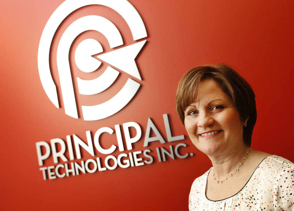 Photo - Pam Fountain-Wilks, president of Principal Technologies staffing company, poses in her company offices. Photo by Steve Gooch, The Oklahoman  Steve Gooch
