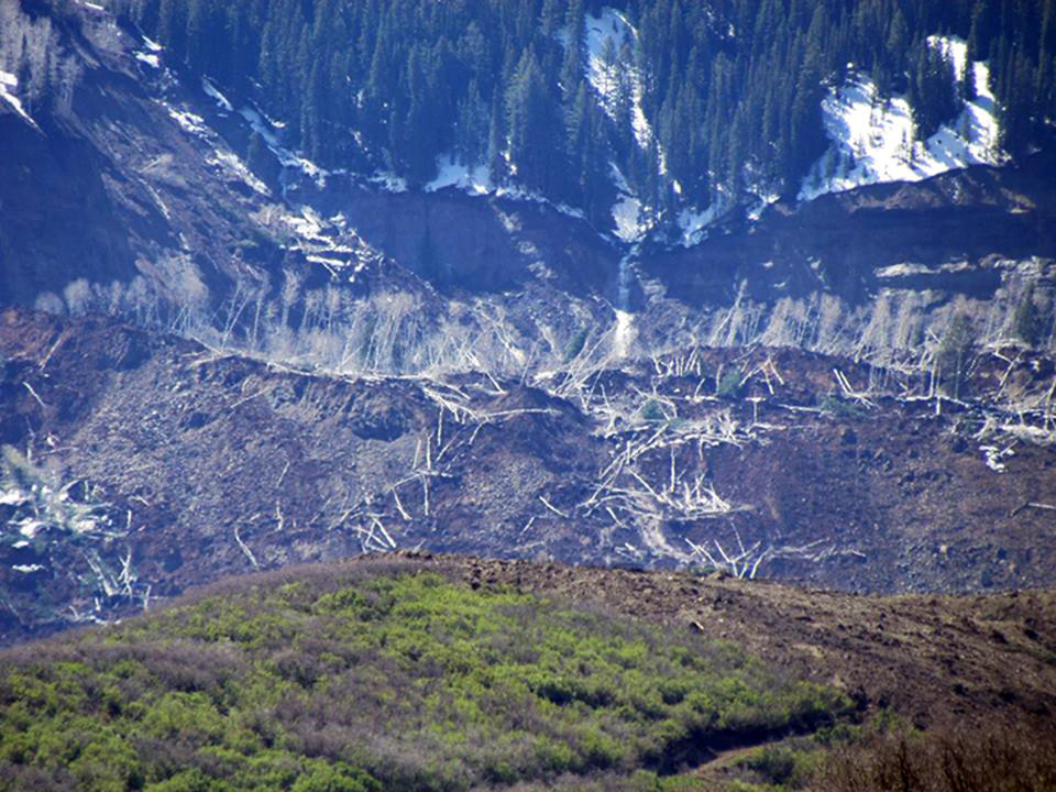 Photo - The results of a three-mile long mudslide are seen on Grand Mesa, where the slide started, in a remote part of western Colorado near the small town of Collbran, Monday, May 26, 2014. Rescue teams are searching for three men missing after a half-mile stretch of a ridge saturated with rain collapsed.(AP Photo/Mesa County Sheriff's Office)