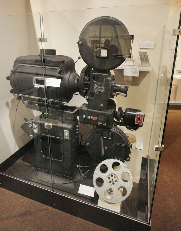 Photo - A 1930s movie projector from the Jewel Theater is on display at the Oklahoma History Center.  PAUL B. SOUTHERLAND - The Oklahoman