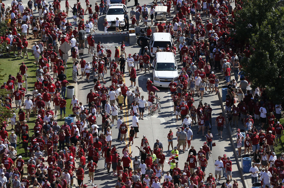 Photo - Fans disperse after greeting the Oklahoma team during their Walk of Champions before a college football game between the University of Oklahoma Sooners (OU) and the Louisiana Tech Bulldogs at Gaylord Family-Oklahoma Memorial Stadium in Norman, Okla., on Saturday, Aug. 30, 2014. Photo by Bryan Terry, The Oklahoman