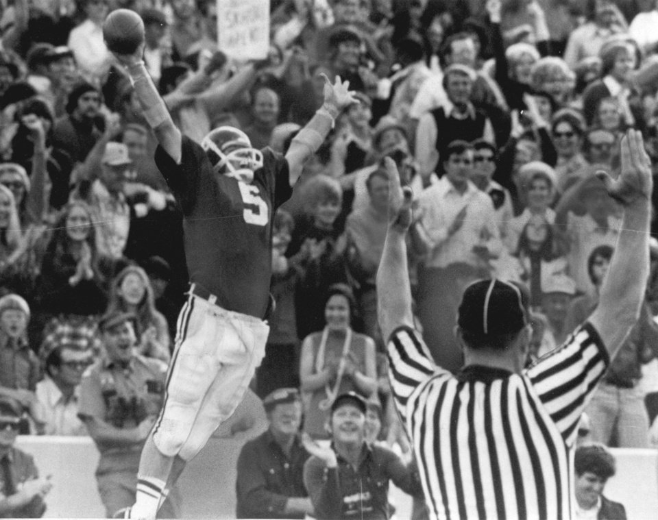 Photo - OU COLLEGE FOOTBALL: 11/24/73. Happiness for Sooners is the outstretched arms of an official and quarterback Steve Davis after one of his three touchdowns against Nebraska. Staff photo by Hank Mooney.
