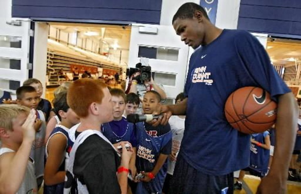 Kevin Durant, of the Oklahoma City Thunder, talks to camp participants during Durant\'s basketball camp at Heritage Hall on Tuesday, June 30, 2009, in Oklahoma City, Okla. Photo by Chris Landsberger