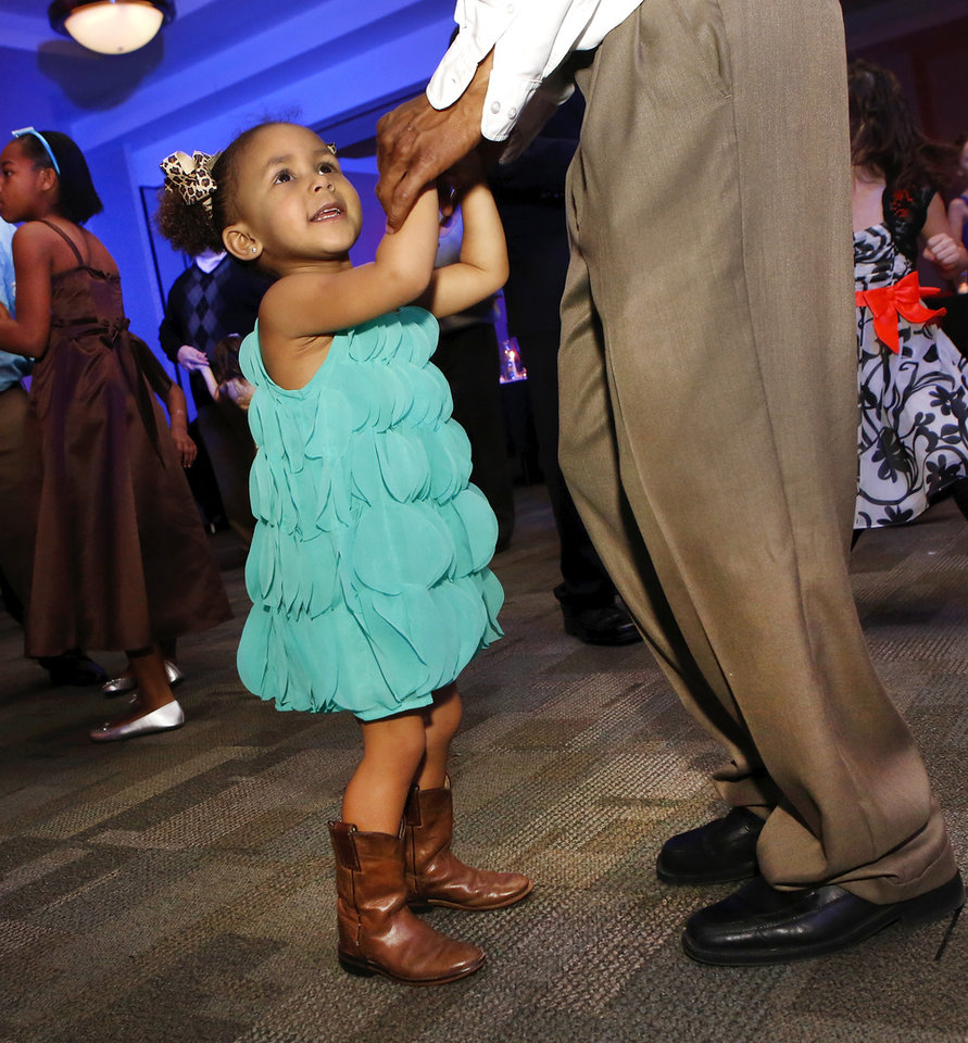 Hadyn Harrell, 3, dances with her dad, Eddie Harrell, Midwest City. Midwest City Parks and Recreation Department hosted the city\'s annual Daddy-Daughter Dance that featured three 90-minute dance sessions at the Reed Center on Saturday, Feb. 16, 2013. Photo by Jim Beckel, The Oklahoman