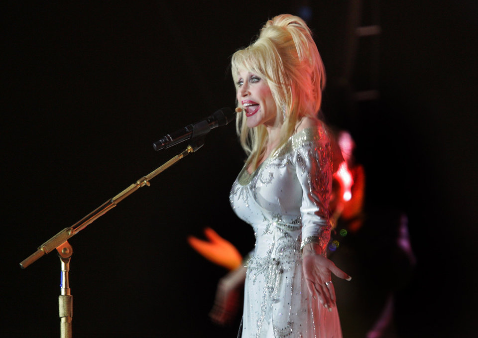Photo - U.S. country singer Dolly Parton performs during her concert in Ijsselhallen in Zwolle, north eastern Netherlands, Sunday March 18, 2007, as part of her European tour. (AP Photo/Peter Dejong) ORG XMIT: PDJ104
