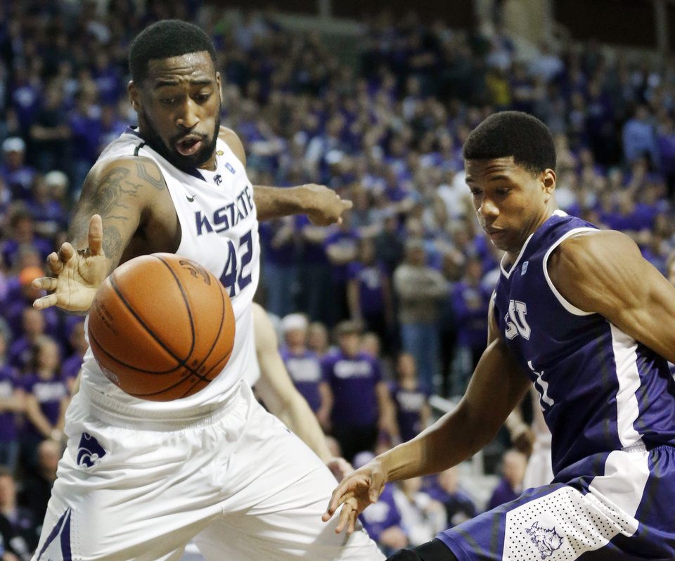 Photo - Kansas State forward Thomas Gipson (42) reaches for the ball while covered by TCU forward Brandon Parrish, right, during the first half of an NCAA college basketball game in Manhattan, Kan., Wednesday, Feb. 19, 2014. (AP Photo/Orlin Wagner)