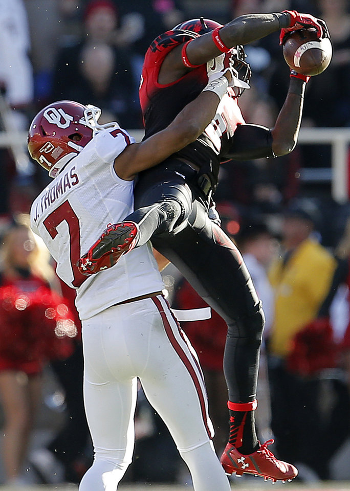 Photo - Oklahoma's Jordan Thomas (7) keeps Texas Tech's Devin Lauderdale (6) from catching the ball during a college football game between the University of Oklahoma Sooners (OU) and the Texas Tech Red Raiders at Jones AT&T Stadium in Lubbock, Texas, Saturday, November 15, 2014.  Photo by Bryan Terry, The Oklahoman