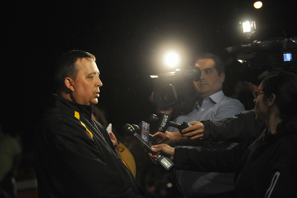 Photo - St. Lawrence County Sheriff Kevin M. Wells addresses the media Thursday night, Aug. 14, 2014 in Heuvelton after Fannie Miller, 12, and her sister Delila Miller, 6, were returned home safely after being abducted the night before. (AP Photo/The Watertown Daily Times, Jason Hunter)