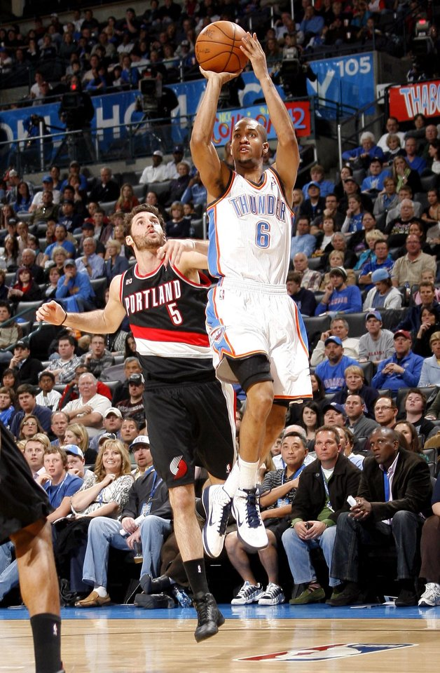 Photo - Oklahoma City's Eric Maynor (6) shoots in front of Portland's Rudy Fernandez (5) during the NBA game between the Oklahoma City Thunder and the Portland Trailblazers, Sunday, March 27, 2011, at the Oklahoma City Arena. Photo by Sarah Phipps, The Oklahoman
