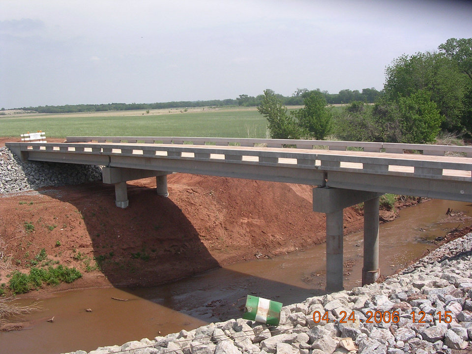 This new concrete structure replaced the old 150' truss span bridge over Cottonwood Creek in Logan County. The old bridge was built in 1920, had a wooden deck, and was declared structurally deficient by bridge inspectors.<br/><b>Community Photo By:</b> Mark Sharpton, Commissioner<br/><b>Submitted By:</b> Mark,