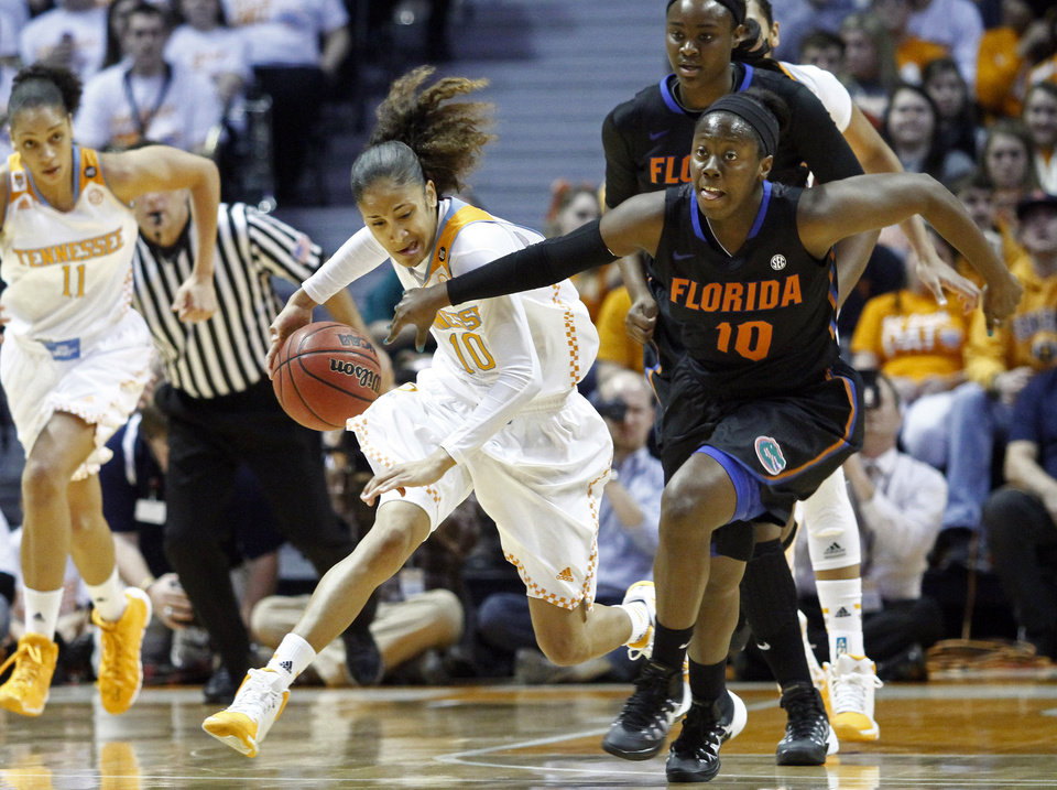Photo - Tennessee guard Meighan Simmons (10) battles for the loose ball with Florida guard Jaterra Bonds (10) in the first half of an NCAA college basketball game Thursday, Jan. 23, 2014, in Knoxville, Tenn. (AP Photo/Wade Payne)