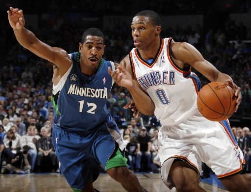 Oklahoma City's Russell Westbrook drives past  Kevin  Ollie of Minnesota during the NBA basketball game between the Oklahoma City Thunder and the Minnesota Timberwolves at the Ford Center in Oklahoma City, Sunday, Nov. 2, 2008. BY NATE BILLINGS