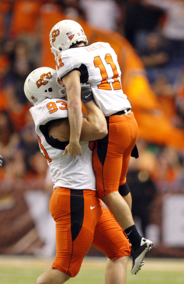 Photo - Oklahoma State's Patrick Hoog (93) and Oklahoma State's Wes Harlan (11) celebrate a field goal during the Valero Alamo Bowl college football game between the Oklahoma State University Cowboys (OSU) and the University of Arizona Wildcats at the Alamodome in San Antonio, Texas, Wednesday, December 29, 2010. OSU won, 36-10. Photo by Sarah Phipps, The Oklahoman