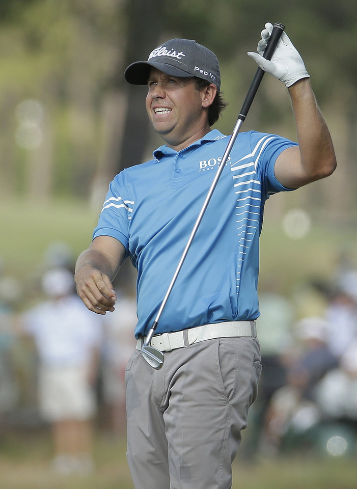 Photo - Erik Compton reacts to his second shot on the 13th hole during the third round of the U.S. Open golf tournament in Pinehurst, N.C., Saturday, June 14, 2014. (AP Photo/Charlie Riedel)