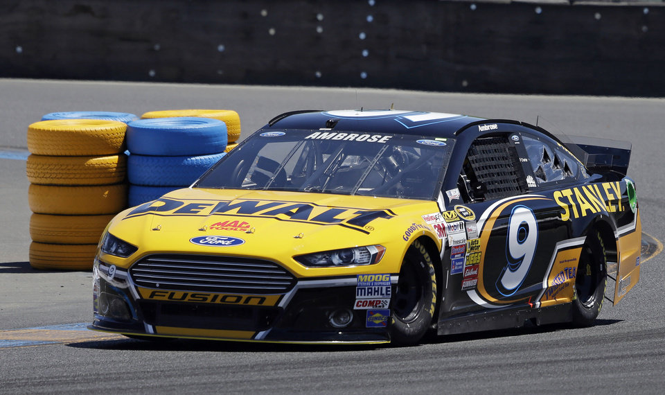 Photo - Marcos Ambrose races during practice for the NASCAR Sprint Cup Series auto race Friday, June 20, 2014, in Sonoma, Calif. Ambrose wants nothing more than to break Hendrick Motorsports' four-race winning streak. His best shot comes Sunday on the road course at Sonoma Raceway, where a win could earn the Australian his first berth in the Chase for the Sprint Cup championship. (AP Photo/Eric Risberg)